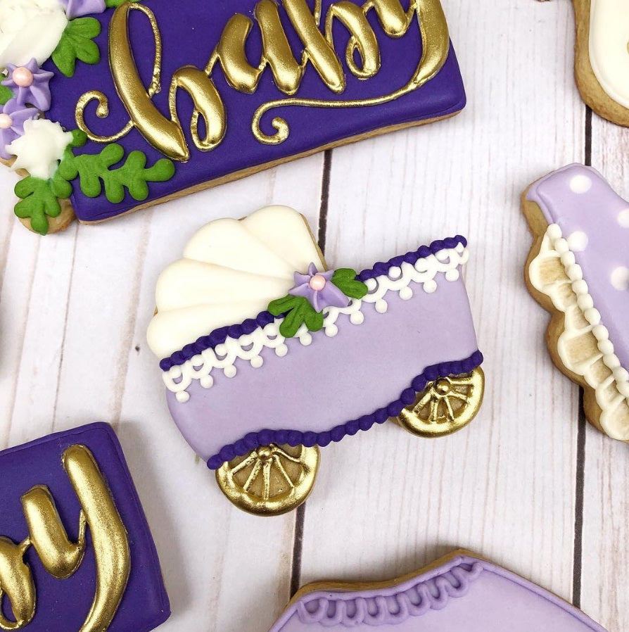 Baby, Purple & Florals Baby Shower Iced Sugar Cookies by @kirkieKookies featured on TheIcedSugarCookie.com #babyshowercookies #babyshowersugarcookies #babyshower #babyshowerparty #purplebabyshower #purplebabyshowercookies #theicedsugarcookie