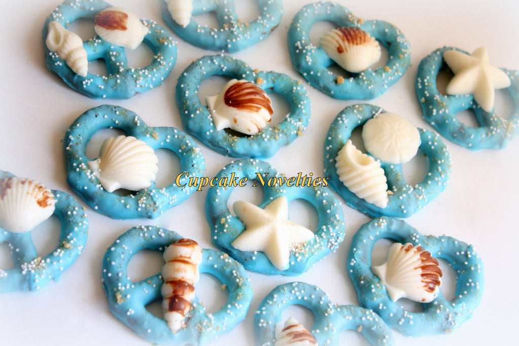 Under The Sea Blue Chocolate Covered Pretzels With White Chocolate Sea Shells. TheIcedSugarCookie.com Cupcake Novelties. Mermaid Birthday Party.