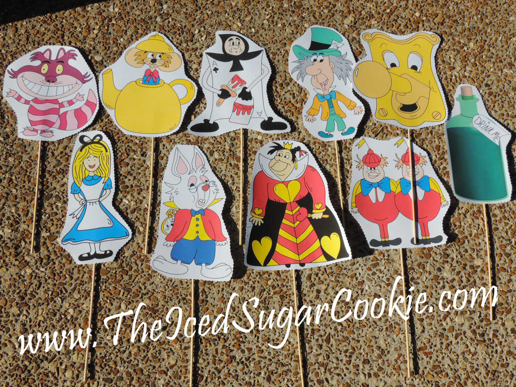 Free Alice In Wonderland Photo Booth Props Printables Birthday Party White Rabbit Tweedle Dee Dum Doorknob Mad Hatter Teapot Mouse Queen of Hearts Drink Me Playing Card Guard Cheshire Cat by The Iced Sugar Cookie