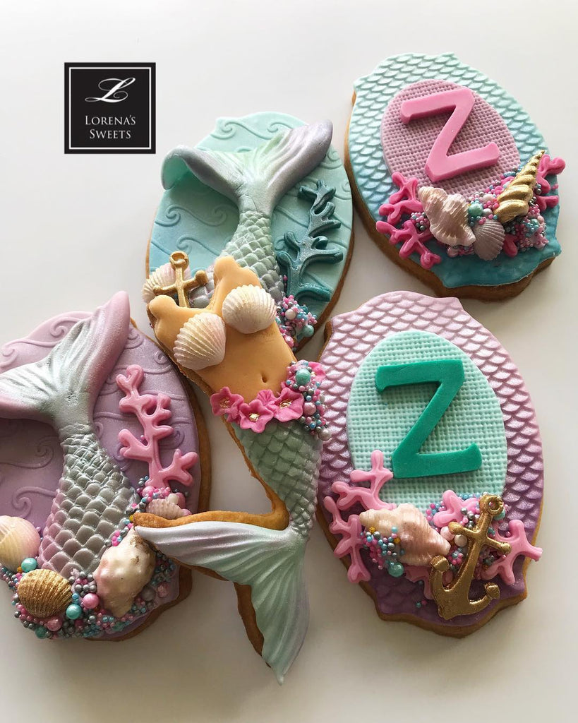 Mermaid Baby Shower Fondant Cookies by @lorenarodriguezsaenz featured on TheIcedSugarCookie.com #mermaidcookies #mermaidparty #mermaids #mermaidbirthday #mermaidbirthdayparty #theicedsugarcookie