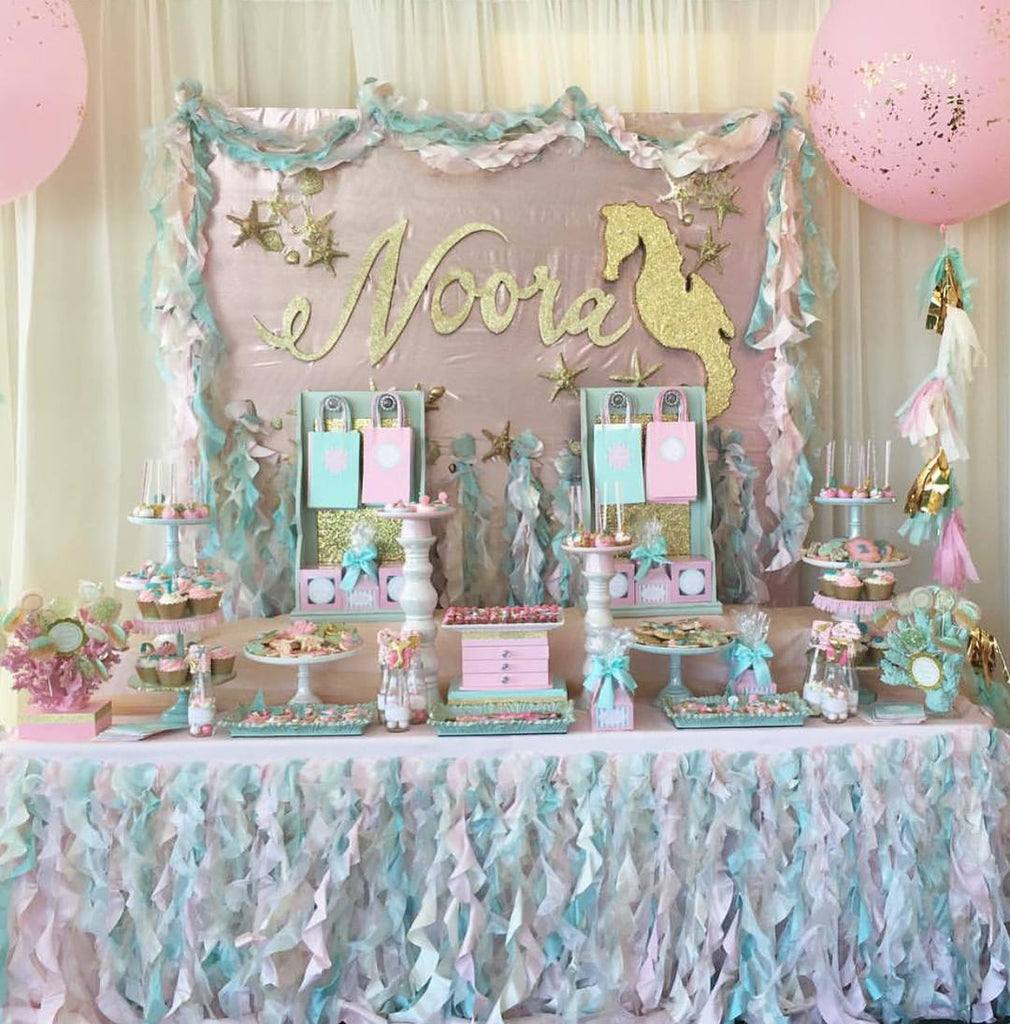 Pink, Aqua & Gold Mermaid Number One Birthday Party featured on TheIcedSugarCookie.com Desserts by @ronisugarcreations Party Planner was by Liza Naguib #mermaidparty #mermaidbirthday #mermaidbirthdayparty #mermaidpartyideas #theicedsugarcookie
