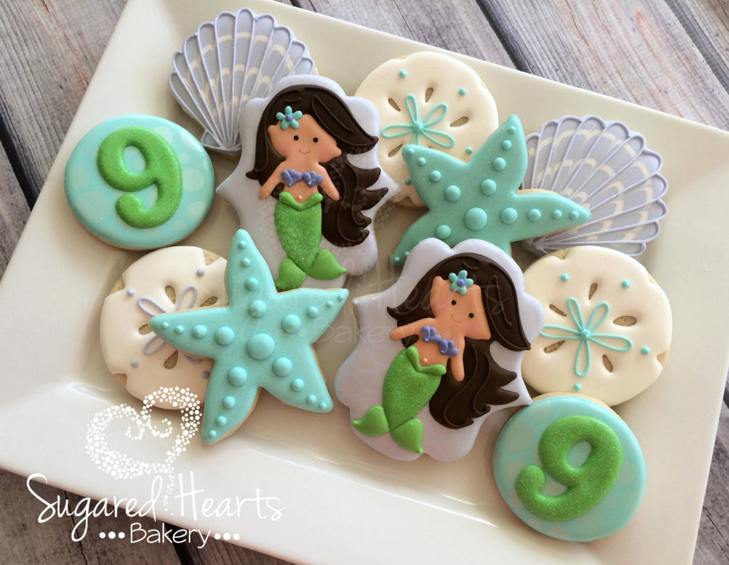 Mermaids And Seashells Birthday Party Sugar Cookies TheIcedSugarCookie.com Sugared Hearts Bakery