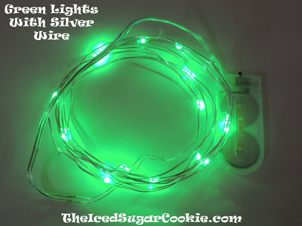 TheIcedSugarCookie.com has Green Birthday Party Lights! Great for baby showers, weddings and bridal showers too! Green Lights on Silver wire. Great for Fall Halloween or Christmas Decorations! Use for The Grinch Christmas Tree Decorations or Monster Mash, Silly Monster, Monster Mash Birthday Party Fall Halloween Party
