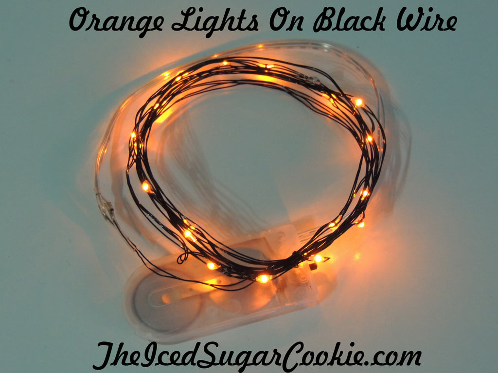 TheIcedSugarCookie.com has Orange Birthday Party Lights! Great for baby showers, weddings and bridal showers too! Orange Lights on black wire. Great for Fall Halloween or Christmas Decorations!