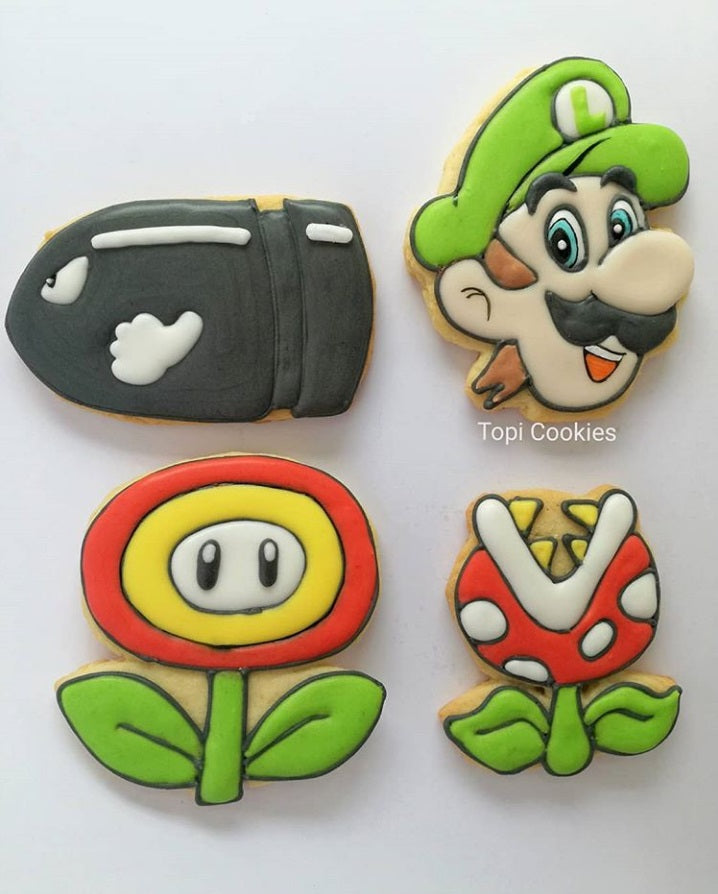 Super Mario Brothers Birthday Party Iced Sugar Cookies by @TopicCookies featured on TheIcedSugarCookie.com #sugarcookies #supermariocookies #supermarioparty #supermariobrothersparty #supermariobrotherscookies #decoratedsugarcookies #theicedsugarcookie