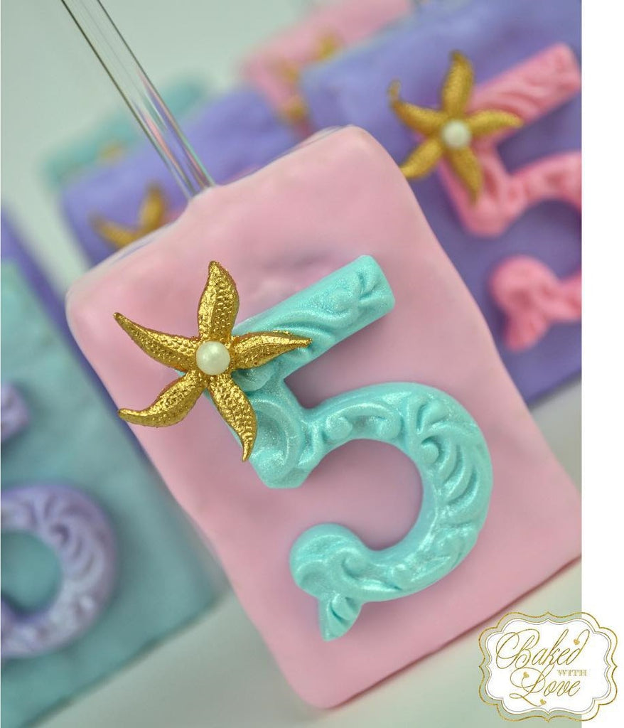 The Little Mermaid Birthday Party Rice Krispy Treats by @_bakedwithlove_ featured on TheIcedSugarCookie.com #mermaidparty #mermaidoreos #mermaidbirthday #mermaidbirthdayparty #mermaidpartryideas #theicedsugarcookie