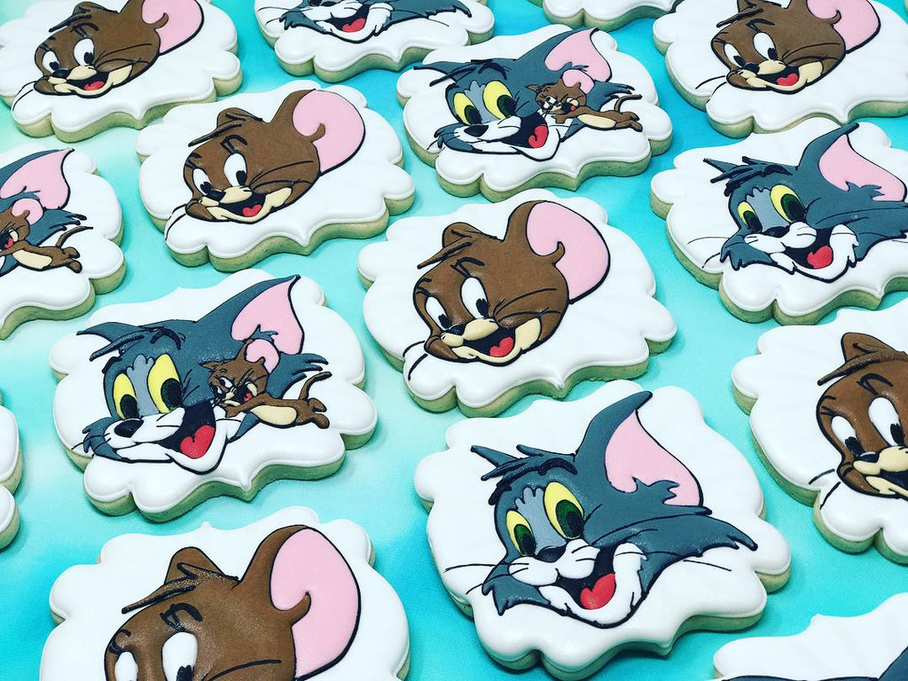 Tom And Jerry Birthday Party Iced Sugar Cookies by @creativeconfectionsbyshannon featured on TheIcedSugarCookie.com #tomandjerrycookies #tomandjerry #decoratedcookies #royalicingcookies #theicedsugarcookie #tomandjerryparty #partyideas #cookies #sugarcookies