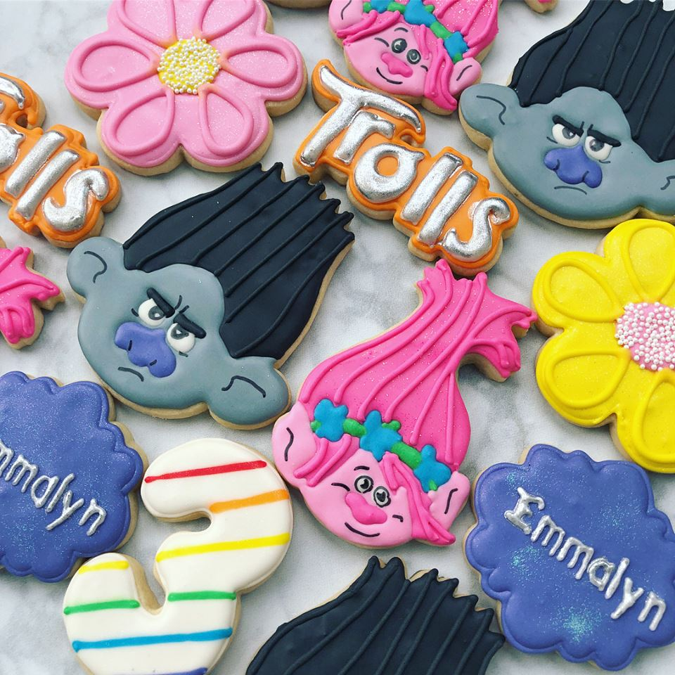 "Trolls Birthday Party Iced Sugar Cookies made by ""Peace Love & Cookies"" featured on TheIcedSugarCookie.com #cookies #trollscookies #trollcookies #sugarcookies #trollsparty #trollspartyideas #trollsbirthdayparty #trollsbirthday #theicedsugarcookie #decoratedcookies #partyideas"