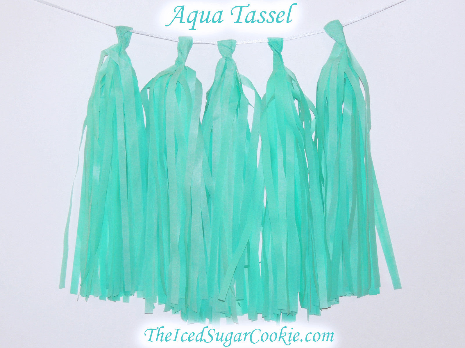 DIY Aqua Tissue Paper Tassel Garland Birthday Party Banner TheIcedSugarCookie.com Great for a Mermaid Birthday Party