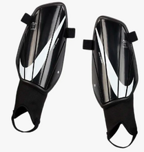Load image into Gallery viewer, Nike Charge Jr. Shin Guards - soccerhome.ca