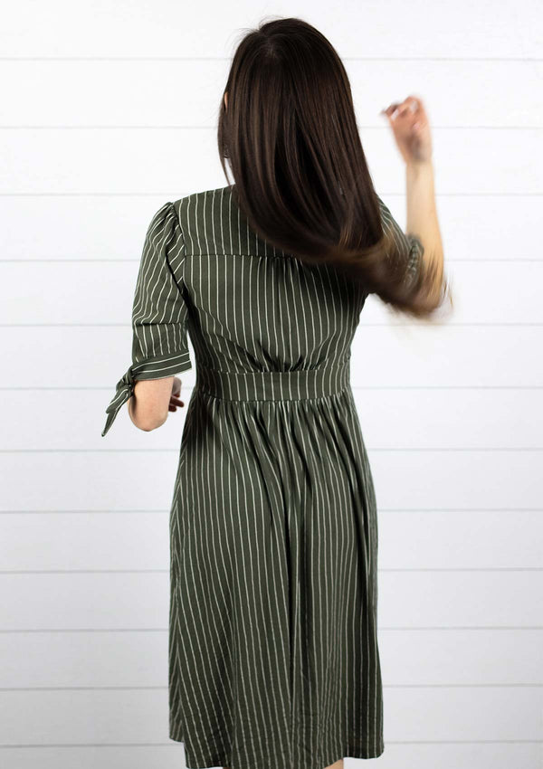 Womens mom friendly olive green midi v neck dress with buttons down front and vertical stripes with tie sleeves