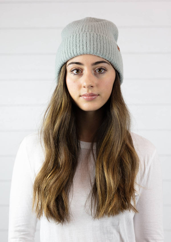 Woman wearing ribbed beanie winter hat in light grey