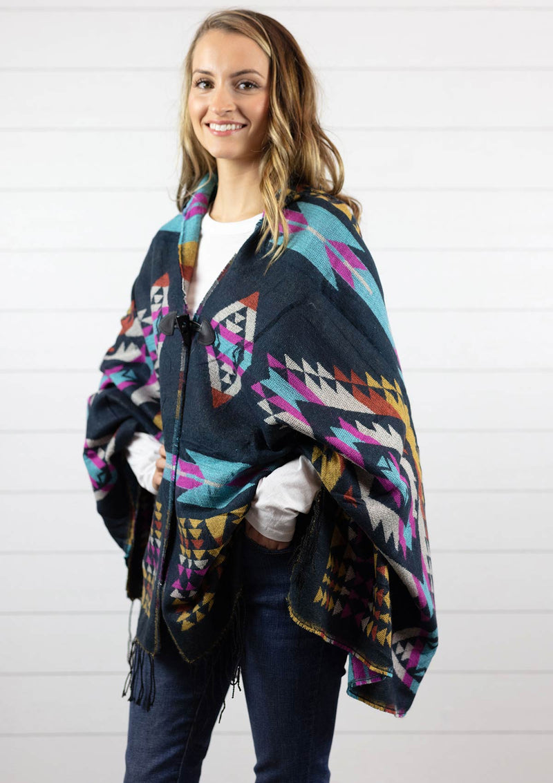 Women's blue Navajo style cape poncho with hood, fringe and toggle closure