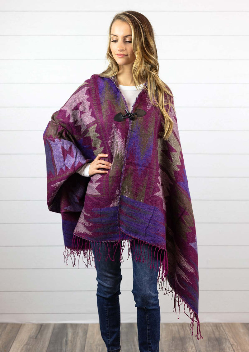 Women's pink navajo style cape poncho with hood, fringe and toggle closure