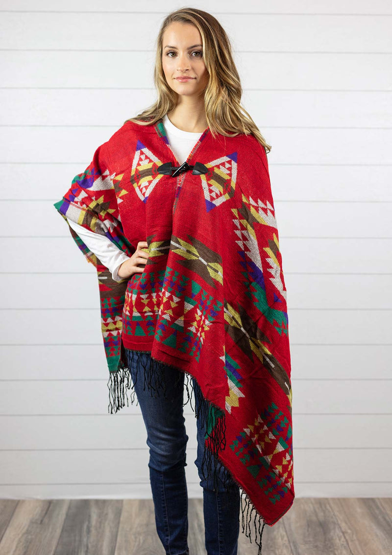 Women's red Navajo style cape poncho with hood, fringe and toggle closure
