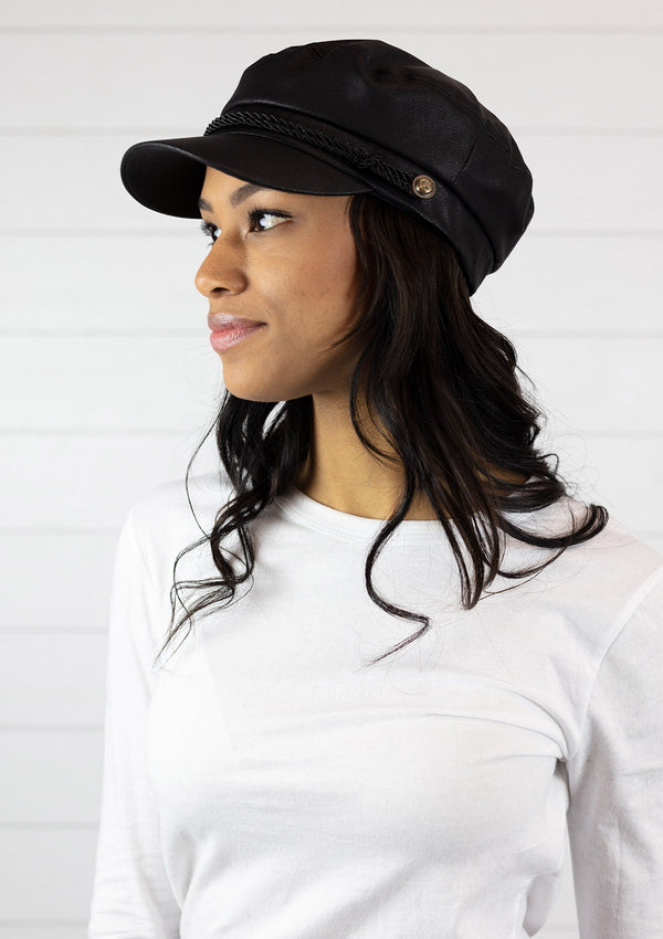 woman wearing a Faux Leather Fisherman Cabbie Hat