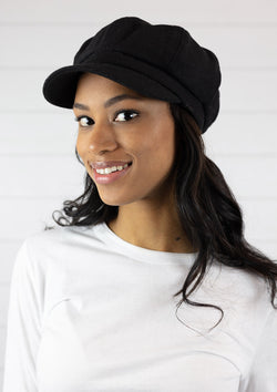 Woman wearing black classic cabbie hat