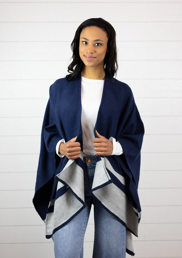 Woman wearing a navy blue and grey striped cape