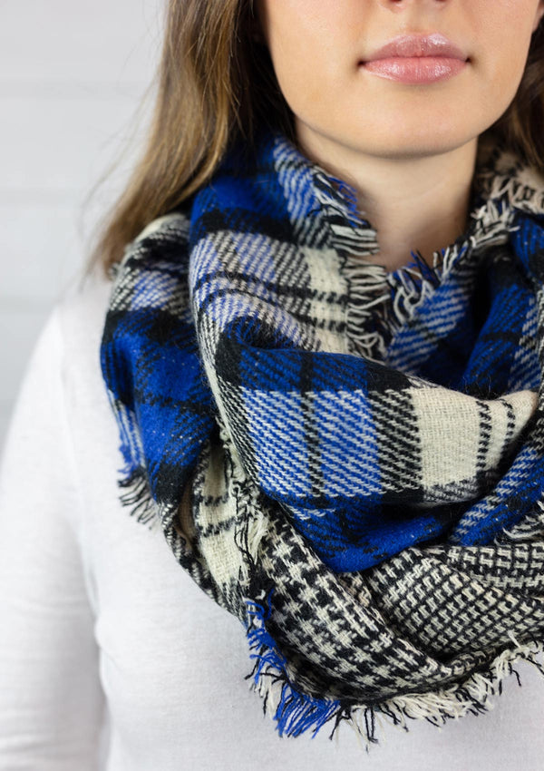 Woman wearing a blue Double Sided Plaid Infinity Scarf