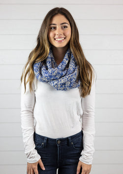 Woman wearing a nordic two tone infinity scarf in blue
