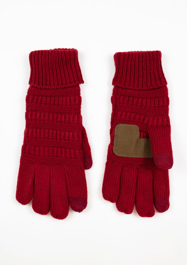 Woman wearing red knit gloves with a suede palm