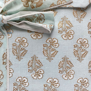 detail: gold block printed flowers on pjs - The Fox and the mermaid