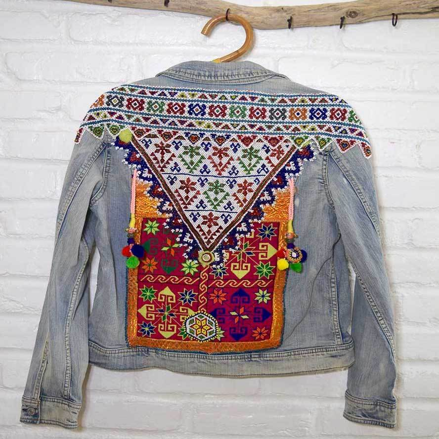White beaded banjara patches with pompoms on denim jacket  The Fox and the Mermaid