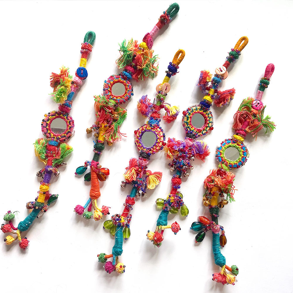 long indian tassels with mirrors, bells, beads and pompoms