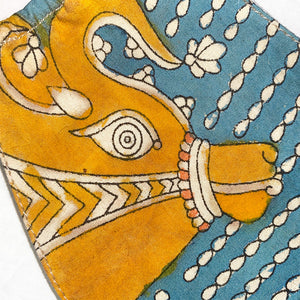 detail of gold indian cow on mask - The Fox and the Mermaid