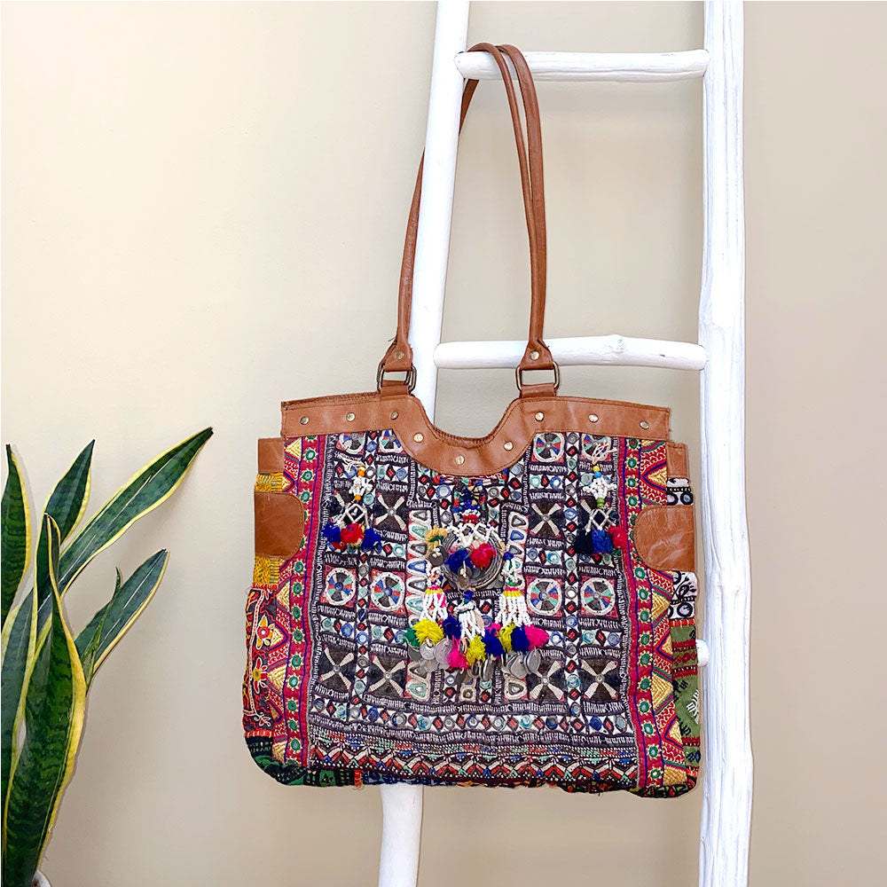 leather banjara bag with danging pompoms and tassels - The Fox and the Mermaid