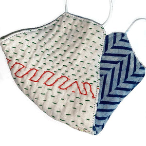 white kantha mask with green and red stitching - The Fox and the Mermaid