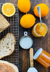 Meyer Lemon Marmalade shown with crusty bread