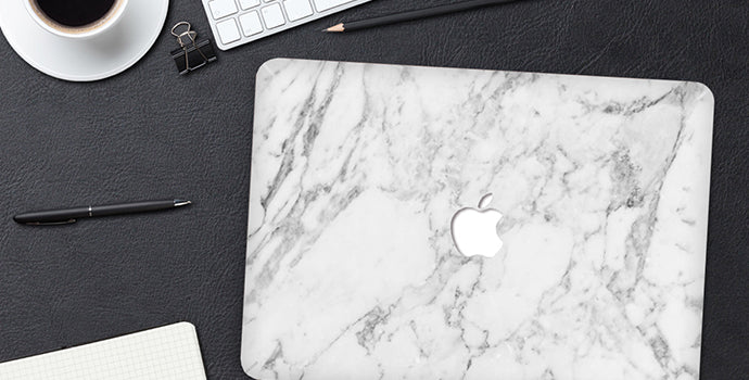 white-marble-laptop-stciker-on-table-with-pens