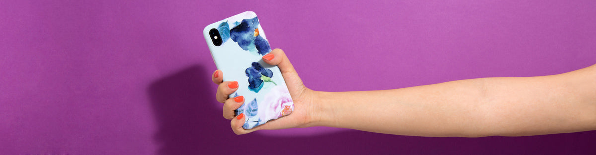 girl-holding-an-floral-iphone-case-in-hand