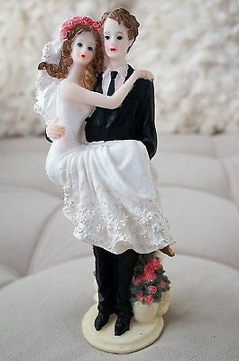 Bride and Groom Cake Topper Carry over Threshold Embrace Pink Roses Figurine- Le Petit Pain