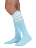 Load image into Gallery viewer, Unisex adult size light baby blue knee high tube sock with three white stripes