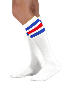 Unisex adult size white knee high tube sock with three royal blue and red stripes