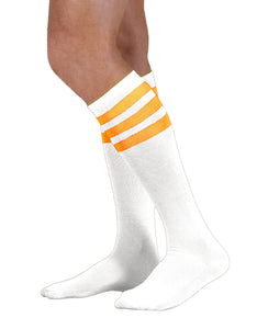 Unisex adult size white knee high tube sock with three fluorescent neon orange stripes
