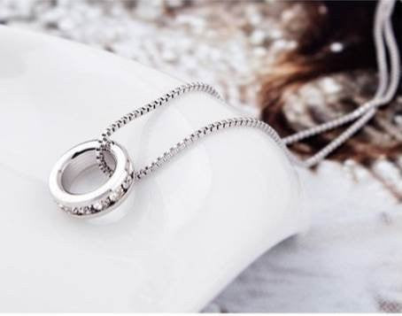 Pop Fashion Silvertone Crystal Studded Ring Pendant Necklace on Silvertone Chain - Pop Fashion