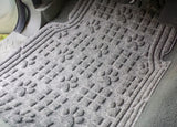 In use shot of a large Paw Print front car mat
