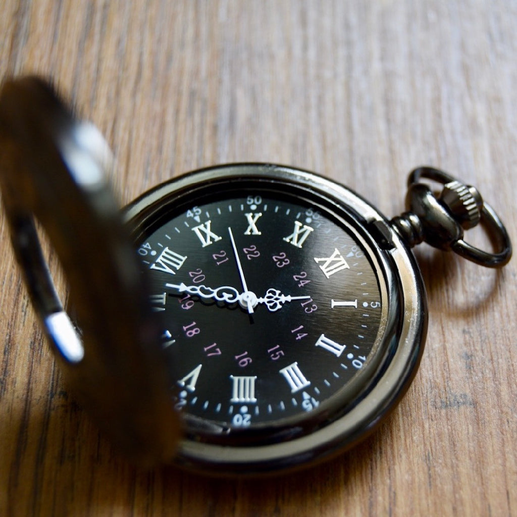 Gunmetal pocket watch open wood