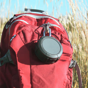 Omnigates Aeon Bluetooth Speaker POD clipped onto a backpack