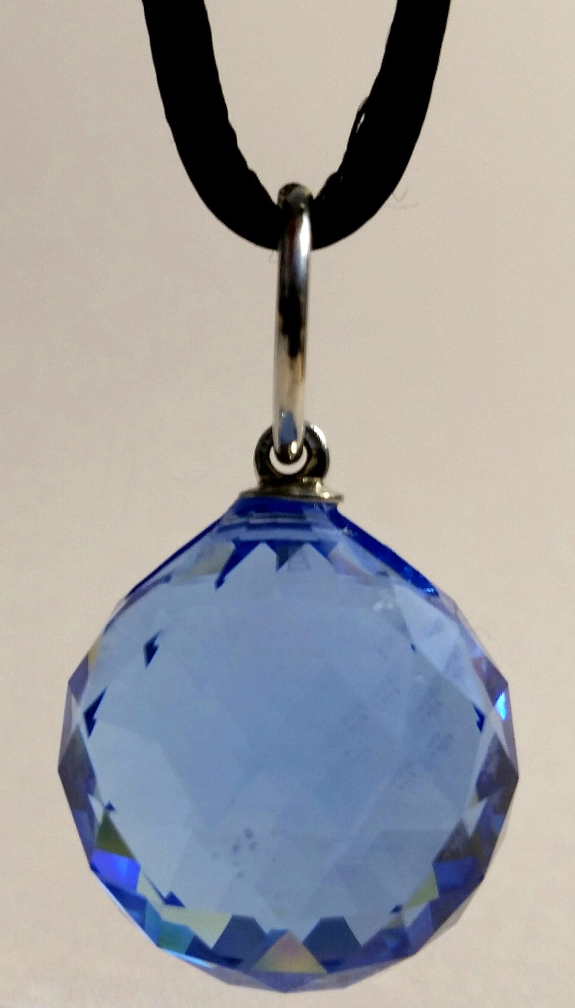 Blue Crystal Ball On A Black Cord