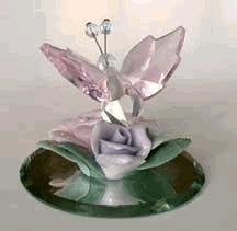 Crystal Butterfly With Pink Wings On Colorful Ceramic Flowers