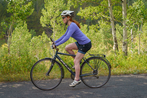 Woman on road bike, wearing Elevenpine skirt and chamois liner.