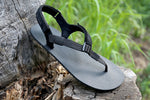 Shamma Warriors sandals in nature on stump