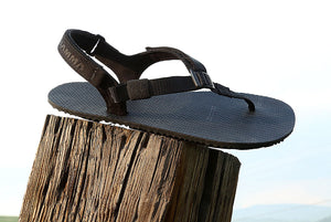 Shamma Warriors sandals on a stump