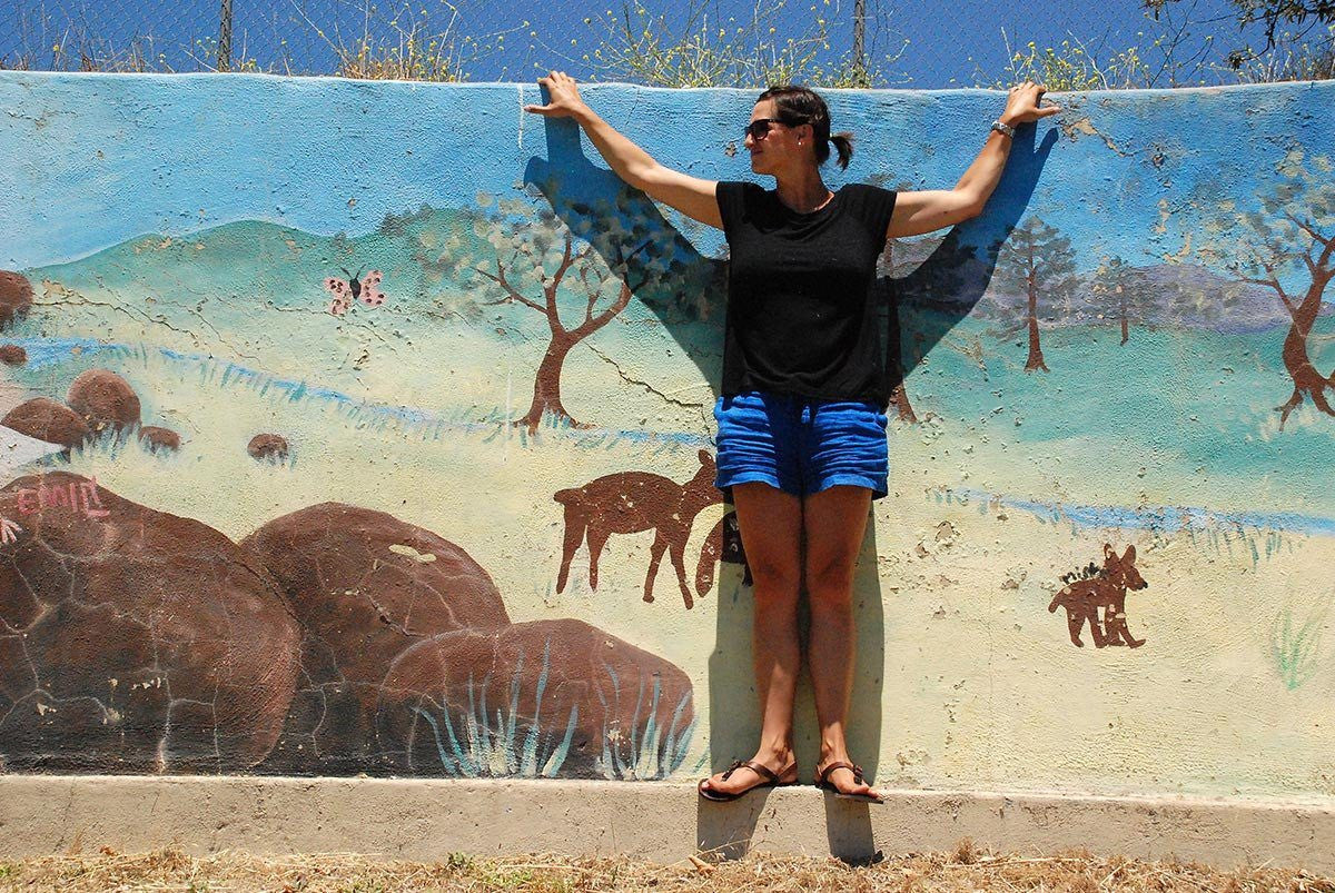Woman wearing Shamma All Browns mural