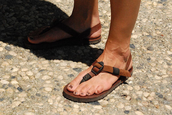 Shamma Old Goats leather sandals woman's feet on cobblestone