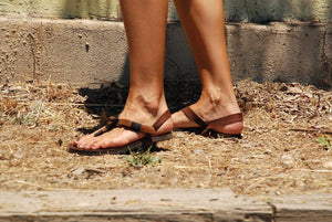 Shamma Old Goats leather sandals woman walking on dirt